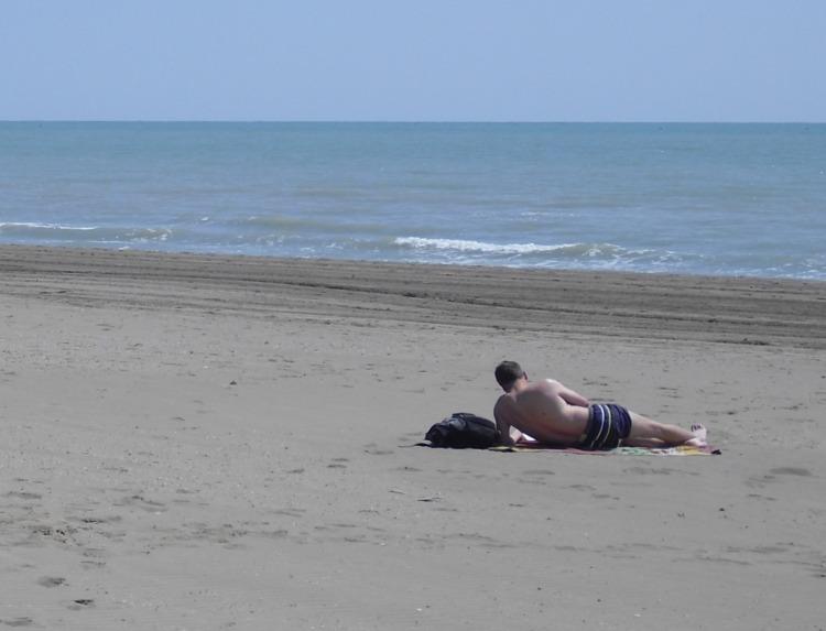 Relax at Ca' Savio beach: reading..