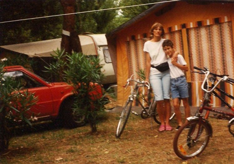 """Mom and me in front of the caravan awning"""